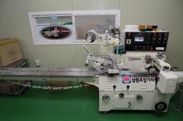 삼면포장기, 삼면기(자동포장기계)